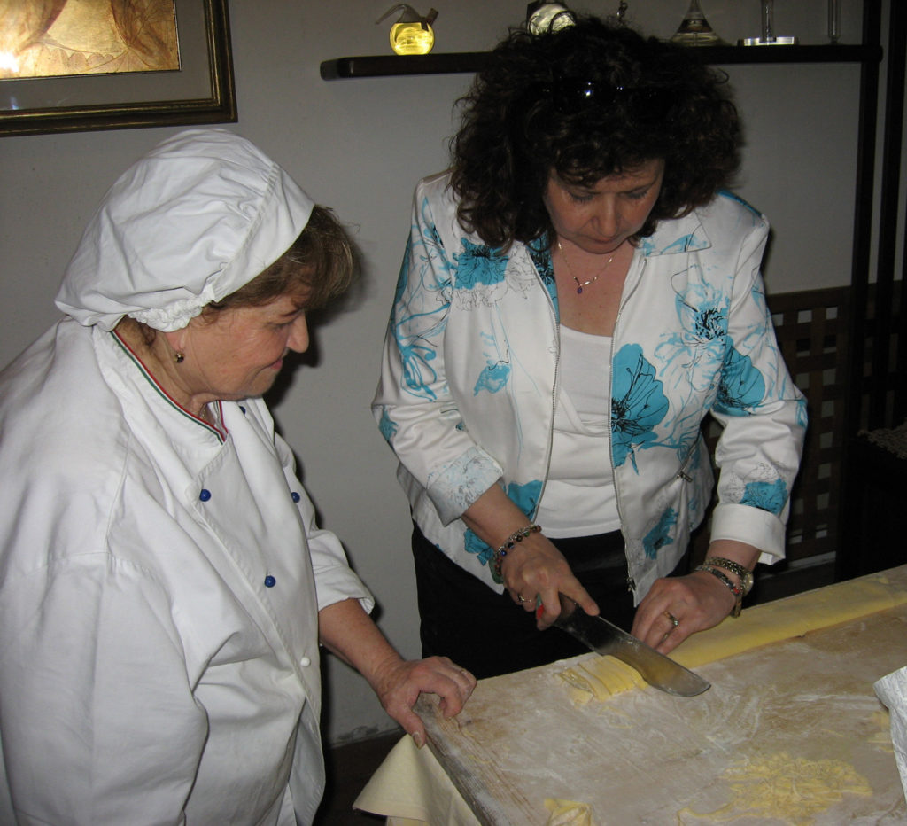 Chef Mirella guiding me on how to cut the strangozzi.
