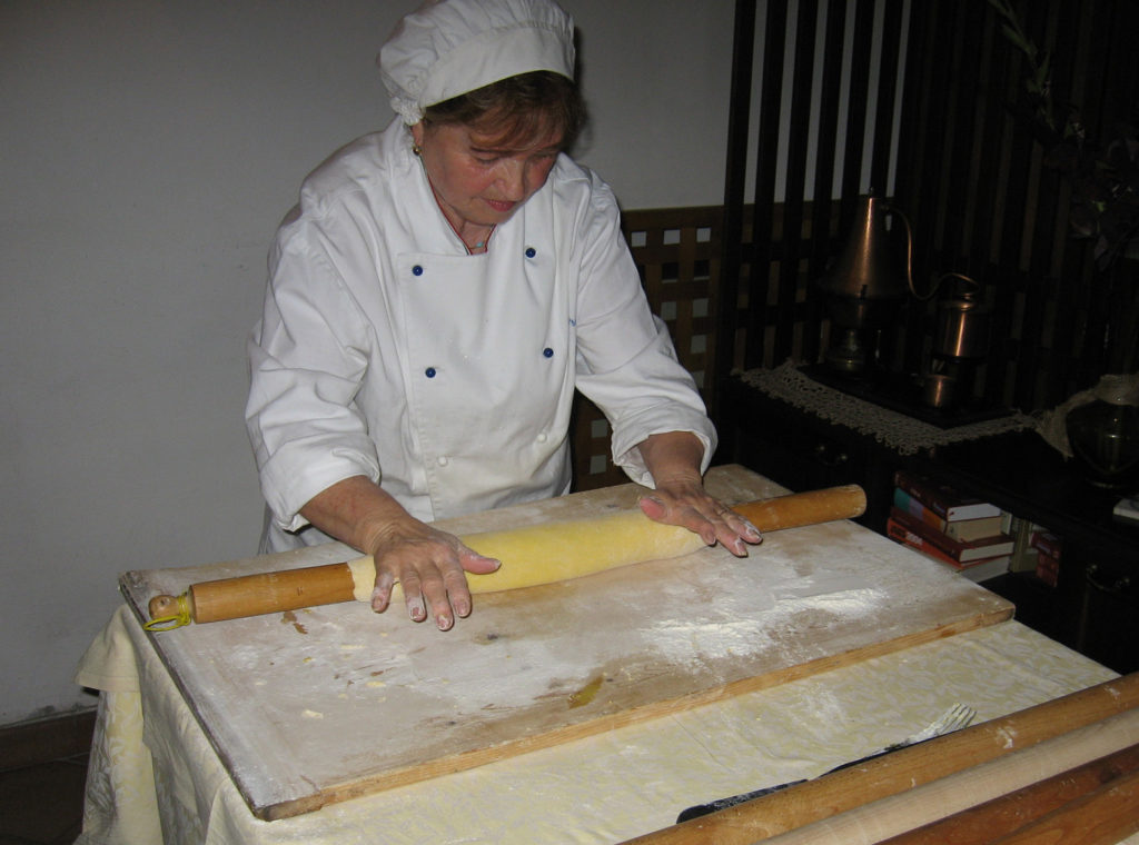 Chef Mirella rolling out the dough for the strangozzi.